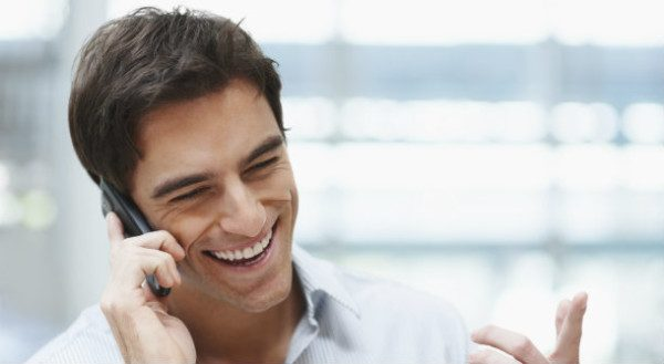 laughing-young-guy-enjoying-a-conversation-over-the-cellphone-5
